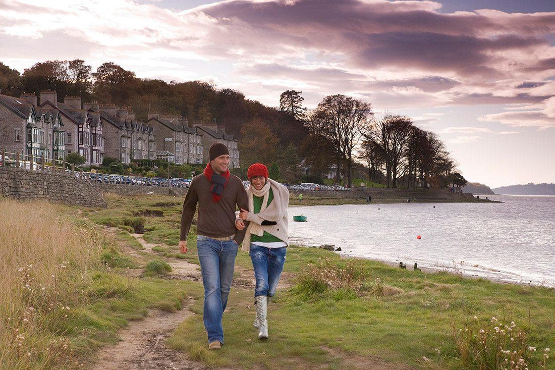 A couple walking along the sea-shore